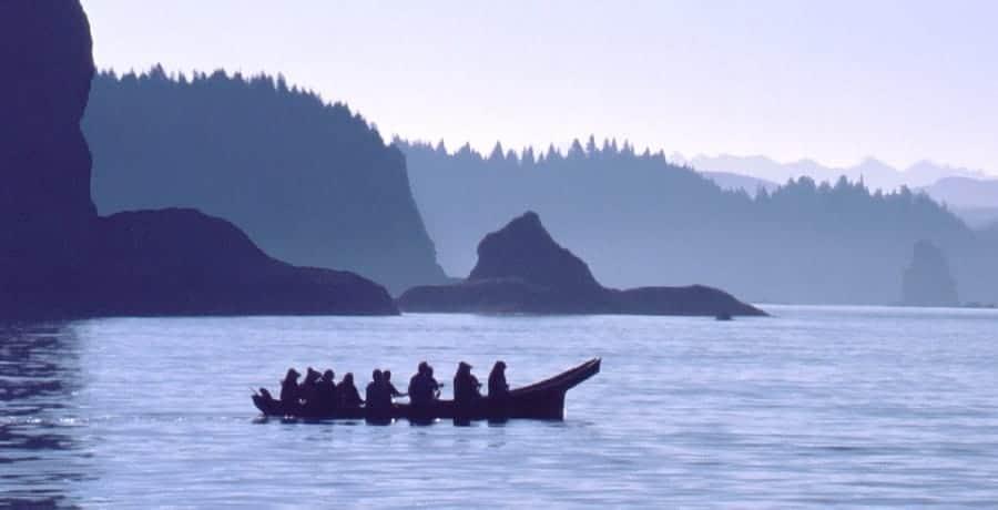 native amerians in canoe